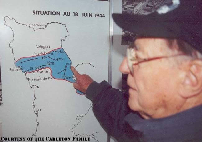 Robert 'Bob' Carleton shows where he landed during D-Day